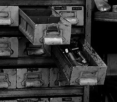 Chest of Bolts (Jade Chanoquaway) Tags: nikon nikkor d5500 blackandwhite black white grey gray grayscale greyscale bw contrast light shadow monochrome silhouette shadows industrial decay metal iron rust rusty rusted rusting abandoned abandon machinery machine machines texture drawer drawers bolt bolts rows peeled paint rectangle shelf shelves september canada ontario shop automotive cans2s