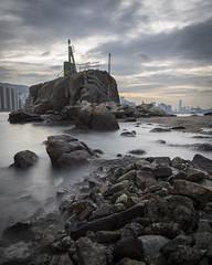 Lei Yue Moon Lighthouse (Lamuel Chung) Tags: lighthouse sunset sun rocks bay bayside ocean harbor sea beach evening weather bad cloudy long exposure nikon d7100 1685 landscape magic hour