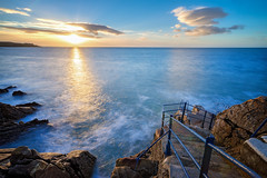 Hawk Cliff, Dalkey, Dublin (Wojtek Piatek) Tags: water sea ocean long exposure sunrise golden hours travel hike dublin ireland sony zeiss a99 a7 steps waves sky clouds sun movement sunday morning leading lines photography landscape seascape photoshop