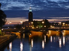 Clouds rolling in (m_artijn) Tags: city hall stadshuset stockholm se blue hour cloud sunset water reflection bridge