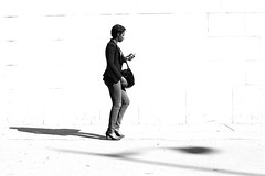 Along the white wall (pascalcolin1) Tags: paris13 mur wall ombres shadows femme woman tlphone phone rverbre soleil sun photoderue streetview urbanarte noiretblanc blackandwhite photopascalcolin