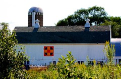 Large dairy barn with quilt (Images by MK) Tags: blue orange white yellow wisconsin barn rural canon quilt farm farming silo cupola dairy argyle wi dairybarn whitebarn t2i barnquilt