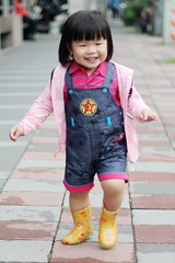 On the way to O2 (Zorie Huang) Tags: light portrait baby cute girl smile asian kid infant child taiwan running lovely taiwanese oneyearold rainboots streetsnap zorie