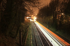 South Gosforth (PhilBehan) Tags: city trees sky urban station night train dark newcastle lights wire long exposure track metro south rail tyne line pylon cables cutting gosforth onenightandadirtylens