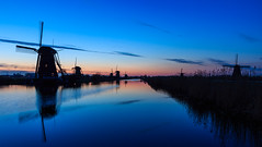 Atmospheric evening at the windmills, Kinderdijk the Netherlands (UNESCO World Heritage Site) (Maria_Globetrotter) Tags: world travel blue panorama heritage tourism architecture canon golden site spring colorful europe day humanity over landmark visit unesco clear hour iconic kinderdijk cultural arkitektur whs vr lightroom mondial patrimoine bl humanidad patrimonio welterbe timmen 650d 1585 vrldsarv landmrke werelderfgoedlijst verdensarven mariaglobetrotter