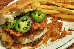 Mmm... BBQ sauced bacon cheeseburger with caramelized onions (jeffreyw) Tags: bacon fries chorizo jalapenos groundbeef bbqsauce caramelizedonions smokedprovolone