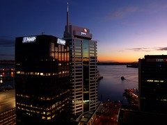 """Sunrise, Auckland City (scinta1) Tags: auckland newzealand city sunrise morning view netartii """"exoticimage pwpartlycloudy colour dark harbour ferry water light sign logo building glass windows reflection early dawn downtown blue calm peaceful lines boat"""