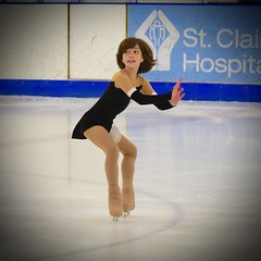 Talented little ball of energy 3 (R.A. Killmer) Tags: skill smile speed skate talented skater performance energy spunky hair fast fearless fly leap spin ice blades edges