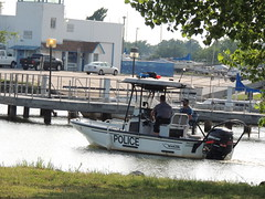 Police boat (Andrew Penney Photography) Tags: lakehefner lake okc 405 thingsisee sunset sunsetorangepearl clouds weather colors orange colorful towed police boat