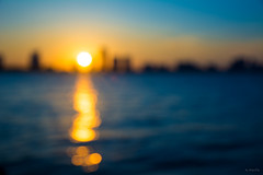Sundown (Andy Marfia) Tags: chicago uptown montrosebeach montrosepier pier beach sunset lake lakemichigan lakefront sky water skyline reflection bokeh outoffocus yellow orange blue summer d7100 1685mm 11000sec f48 iso100