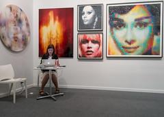 Woman and Portraits (UrbanphotoZ) Tags: artnewyorkcontext artshow portraits woman gallerist macbook faces colored pixelated flame blurred photographs farwestside manhattan newyorkcity newyork nyc ny