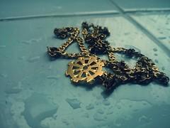 Unattended Gold (esala.kaluperuma) Tags: wheel buddhism chain art abstract photograph esala kaluperuma uk coalville religious religion