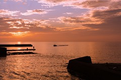Seaside Sunset (mon_masa) Tags: sunset sunlight sea seascape seaside seashore settingsun japan landscape scenery boat silhouette sun cloud backlight backlit