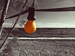 Orange light on the beach (panoskaralis) Tags: lights light orange lamp beach fygokentrosbeach charamida shore coast lesbos lesvosisland lesvos mytilene greece greek hellas hellenic sea seaside bluesea sky bluesky sony sonydschx60