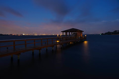 The Wait. (+Lonnie & Lou+) Tags: night longexposure sky duval jacksonville florida tennant sony canon september clouds travel usa landscape waterscape dock pier skyline architecture blue building purple boat smooth tranquil serene calm