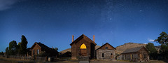 church lights (Flint Roads) Tags: bannack mt montana blue bluesky chimney church clouds fence ghosttown highplains house lightpainting night nightsky panorama stars town window yellow