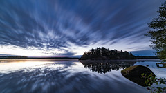 A sense of movement (jarnasen) Tags: d810 nikon longexposure le 2min dawn sunrise clouds sky movingclouds reflections water rock island horizon tripod trees calm mood copyright jrnsen jarnasen vrdns stergtland storarngen lake nordiclandscape landscape lakescape morning light 14mm samyang samyang14mmf28 wide angle pov explore explored