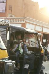 holding on tightly (Magne M) Tags: auto street boy india black girl yellow kids backlight asia traffic candid taxi calm tuktuk rickshaw jaipur streetpeople autorickshaw streetshot pinkcity holdontight