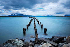 Stuck in Time (danielpivnick) Tags: chile old longexposure patagonia storm mountains southamerica water clouds landscape rocks windy sound torresdelpaine pilings strait fjords d800 puertonatales oldpier torresdelpainenationalpark nikond800
