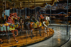Galloping Off Into the Night (SunnyDazzled) Tags: park city nyc longexposure bridge horses newyork window glass childhood brooklyn night reflections lights amusement cityscape ride dumbo carousel carouselhorses manhattanbridge imagination janes mygearandme