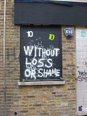 Without loss or shame (Niecieden) Tags: november streetart black london graffiti 10 numbers shoreditch shutter 2009 towerhamlets freehandgraffiti niecieden canondigitalixus90is
