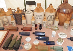 A collection of antique bottles, pots, and stoneware jars at the Great Dorset Steam Fair (Anguskirk) Tags: old uk blue green bottles vincent dorset antiques 2009 gingerbeer jars groves stent stoneware mineralwater nobbs greatdorsetsteamfair seymours collectorsitems scutt anchovypaste gdsf tarranthinton durnovarian jaschkes