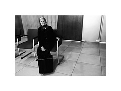 old widow in the bank (Marek Pupk) Tags: central europe slovakia blackandwhite bw documentary monochrome old woman bank apple iphone 5s