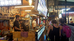 Decisions, decisions... (Roving I) Tags: tourism tourists travel backpackers backpacks benthanhstreetfoodmarket saigon stalls cooks hcmc hochiminhcity vietnam choice deciding dining