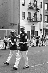 African American Day Parade I (sphaisell) Tags: newyork nuevayork harlem us america africanamerican africanamericanday africanamericandayparade men officer officers uniform uniforms blackandwhite symmetry bw composition hats fireescape parade carnival procession street streetphotography candid urban urbanphotography