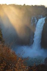 Victoria Falls at dusk, Zimbabwe (fame&obscurity) Tags: waterfall waterfalls victoriafalls zimbabwe zambia africa zambezi zambeziriver mosioatunya water sun sunlight sunbeam goldenhour nature
