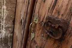 Characterful doors (PChamaeleoMH) Tags: ciutadella door doorhandle menorca wood