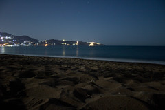 Nighttime On The Beach (AlexAncuPhoto) Tags: night sky dark black sunset after blue stars starry houses hill cityscape mountain sea water long exposure travel beach summer sand wave foam crete greece vacation