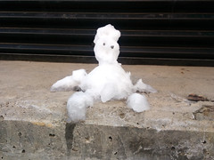 Melted Snowman (Exile on Ontario St) Tags: snowman bonhomme de neige montral hiver winter snow melted melting fondu fonte melt montreal little tiny small petit bton concrete sad triste eyes yeux beady