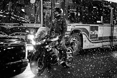 Riding on a Chilly Night (Explored) (Jake Jung) Tags: street blackandwhite bw snow monochrome japan kyoto candid sony streetphotography  getty editorial   gettyimages motocycle flickrvision shijo   apsc nex7 sel50f18 e50mmf18oss jakejung