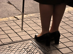 with notes of Chopin (Marco San Martin) Tags: street woman walking calle mujer shoes police zapatos chopin uniformed inuniform mujercaminando marcosanmartin withnotesofchopin