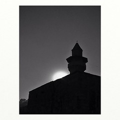 Sunset over a mosque (Deir el Qamar, Lebanon. Gustavo Thomas  2004-2013) (Gustavo Thomas) Tags: sunset blackandwhite lebanon sun sol square atardecer muslim islam middleeast mosque squareformat mezquita puesta lebanese bnw liban lbano travelog moyenorient deirelqamar iphoneography instagramapp uploaded:by=instagram