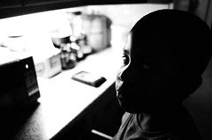 Dominic in the Kitchen. (Dominica69) Tags: white black london film kitchen 35mm nikon f and hp5 analogue ilford dominic