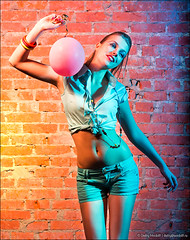 Girl dancing with balloon (Dmitry Mordolff) Tags: pink blue girls people woman playing cute beautiful face female mouth studio fun one women hand open expression humor balloon anger human blond fist shorts punch emotional screaming adults bizarre furious caucasian lifestyles displeased 2025 expressing