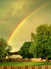 Golden Hour Double Rainbow (Dane Vandeputte) Tags: wood trees sky clouds yard canon fence golden evening is wooden illinois rainbow backyard magic double powershot il foliage hour aurora woodenfence doublerainbow magichour goldenhour woodfence aurorail sx210 canonpowershotsx210is