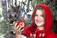 Little Red Riding Hood and the Big Bad Wolf (Francis Jimnez Meca) Tags: red wild people fall girl smiling animal danger forest fun outside costume big wolf play little bad dressup littleredridinghood chase cloak bigbadwolf adults tale redapple