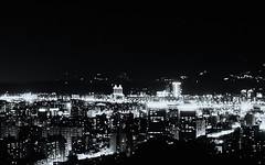 Taipei Noir - 04 (bluetrayne) Tags: city longexposure nightphotography urban building monochrome architecture skyscraper asia cityscape taiwan citylights taipei analogphotography  blackandwhitephotography