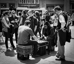 Forever 21 (Ash and Debris) Tags: usa crowd street people city play streetlife bw urban monochrome nyc chess life blackandwhile bnw game citylife newyork