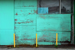Indy#14917_Copy (Single-Tooth Productions) Tags: abandoned abandonedbuilding decay decaying boardedupbuilding bollards yellowbollards neglect grim bleak composition colorcomposition architecturalcomposition shapes lines colorblocks reflections 2d flat window architecture architecturaldetail architecturaldecay paintedplywood aqua yellow ewashingtonst indianapolis indiana urban city building buildingdetail buildingcomposition buildingdecay urbandecay 50mm nikkor nikkor50mm nikond200 nikon