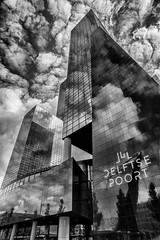 Cloud explosion @ Delftse Poort (Rotterdam) (PaulHoo) Tags: clouds sky skyscraper rotterdam city urban reflection hdr contrast mirror glass delftse poort bw blackandwhite monochrome holland netherlands architecture building wideangle nikon d700 nik colorefex silverefex explosion