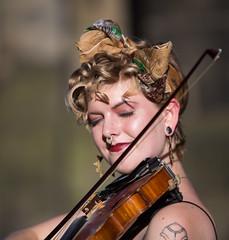 Faith - 3 (Alastair 2008) Tags: fiddle female street entertainer bow piercing strap blacktop