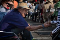 Reaching across the Aisle (stefanws) Tags: oakland people nikon d750 handshake seniorcitizen child toddler elderly man reaching touching california generation children streetscene moment generations