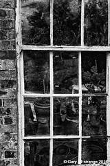 The broken window (garylestrangephotography) Tags: beaulieuhouse conservatory glass reflected reflection drogheda louth ireland window frame wood brick garden history culture black blackandwhite blackwhite white grey monochrome mono monotone tourism touristlocation touristattraction tourist outdoor flower pot