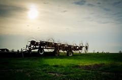 Sundown on the Farm (Truebritgal) Tags: ranch blue ohio sky cloud sun tractor green grass wheel yellow rural lens nikon scenery farm country farming tire equipment nikkor tyre jewett grassy tines againstthesun faithranch 18200mm d7000 truebritgal