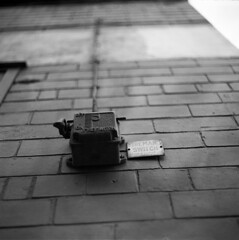 Fireman's Switch (Gabo Barreto) Tags: uk england slr 120 6x6 film sign wall mediumformat switch focus dof bokeh yorkshire bricks leeds tmx emofin tetenal sovietcamera twobathdeveloper