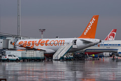 EasyJet A320 (n_dunaev) Tags: uk rain weather clouds plane airplane shower flying spring airport moscow aircraft flight landing airline airbus gb airlines takeoff spotting dme easyjet a320 planespotting domodedovo